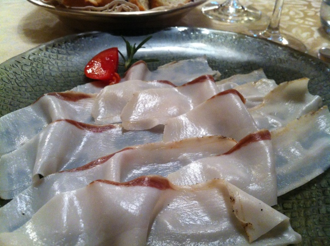 A close up look - wafer-thin slices of Lardo do Colonnata